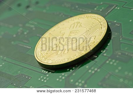 Golden Bitcoin On Green Printed Circuit Board