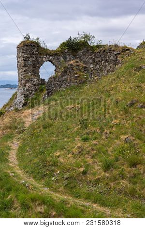 Stromeferry, Scotland - June 10, 2012: Path Leading Up Green Hill To Window In Rock Wall Of Castle S