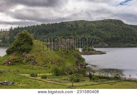 Stromeferry, Scotland - June 10, 2012: Entire Castle Strome Ruins On Green Hill At Loch Carron.  Mou