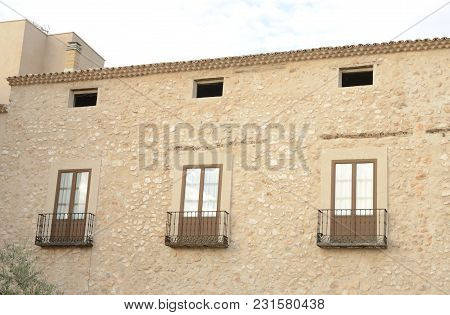 Balconies On Facade Of Stone Building  In The Village Of Belmonte, Province Of Cuenca, Spain.