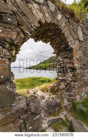 Stromeferry, Scotland - June 10, 2012: Closeup Of Window In Rock Wall Of Castle Strome Ruins On Gree