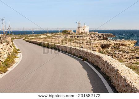 The Lighthouse Of Punta Marsala On The East Coast Of The Island Of Favignana With The Coast Of Sicil