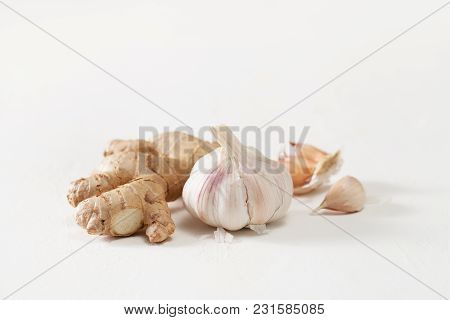 Garlic Heads And Ginger Root On White Background