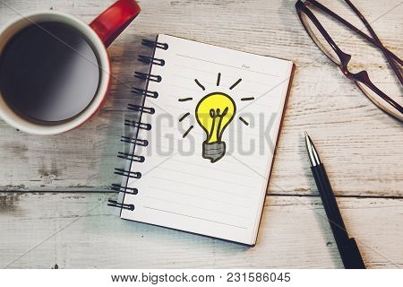 Idea On Notebook With Coffee On The Table