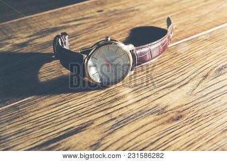 Vintage Style Of Luxury Men Watch On Wooden Table
