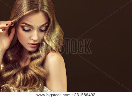 Brunette  Girl With Long  And   Shiny Curly Hair .  Beautiful  Model Woman  With Wavy Hairstyle   .c