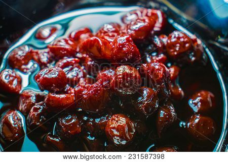 Cherry Sweet Jam - Jam In A Black Glossy Plate On The Stands On The Table. Shines And Looks Very App
