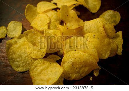 Potato Fried Golden Chips Lie On The Baking. Chips Are Oval And Round. Look Appetizing And Tempting