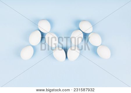 White Eggs In Form Of Letter