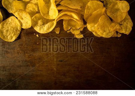 Bright, Yellow, Crispy Potato Chips On A Worn Background, Pastries. Deep-fried, American Food. They