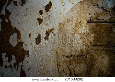 Old Elements Of The Construction Of Concrete, Gypsum And Loose Wood, Boards. Inside The Collapsed Ro
