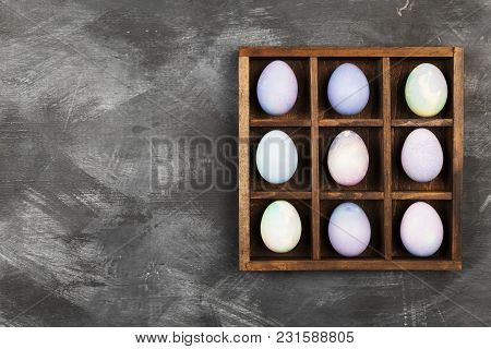 Multicolored Eggs For Easter On Black Background. Top View, Copy Space. Food Background