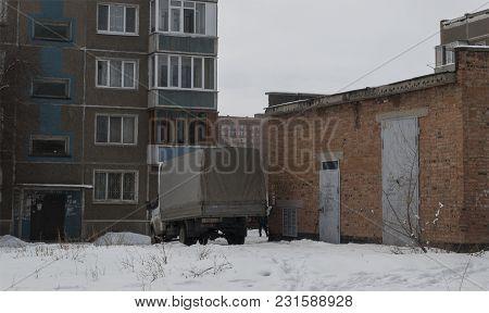 Kazakhstan, Ust-kamenogorsk, March 16, 2018: Yard Of One Of The Houses. Grunge Urban Landscape. City