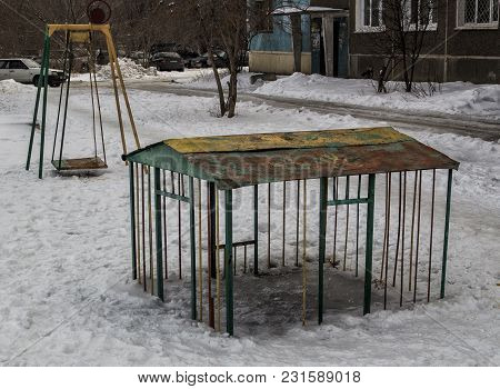 Old Children Playground. Soviet Children Playground. Apartment Building. Grunge Landscape