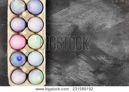 Multicolored Eggs For Easter In Container For Eggs On Black Background. Top View, Copy Space. Food B