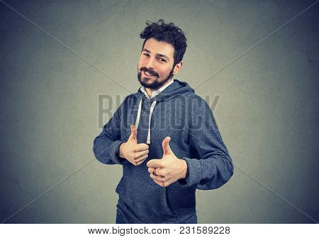 Cheerful Man Excited With Win Giving Thumbs Up Gesture