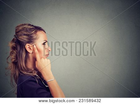Side View Of Elegant Woman Touching Temple And Looking Away While Making Decision.
