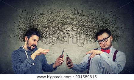 Two Men Manipulating Internet With Smarpthones Exchanging With Multiple Ideas And Thoughts