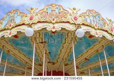 Attraction merry-go-round, beautiful game for children with colorful horses and fun in an outdoor park