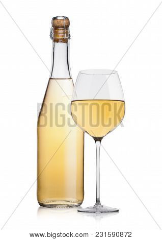 Bottle Of Homemade White Wine And Glass On White Background With Reflection