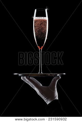 Hand With Glove Holds Tray With Champagne Glass