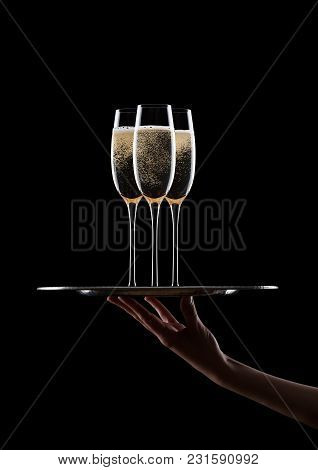 Hand Holds Tray With Yellow Champagne Glasses
