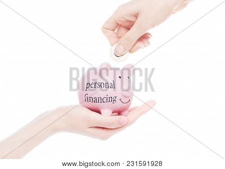 Female Hand Holds Piggy Bank With Personal Financing Concept Text Hand Putting Coin Inside On White