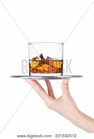 Hand Holds Tray With Glass Of Whiskey And Ice Cubes On White Background