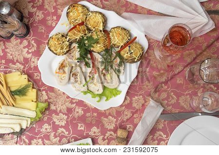 Served Holiday Table With Various Salads, Hot And Cold Snacks, Alcoholic Beverages And Juices