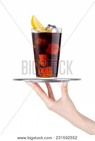Hand Holds Tray With Cola Soda Drink With Ice And Lemon On White Background