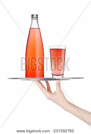 Hand Holds Tray With Pink Lemonade Soda Drink Bottle And Glass  On White Background