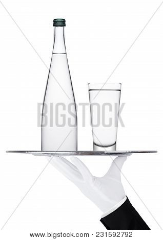 Hand With Glove Holds Tray With Bottle And Glass Of Still Water On White Background