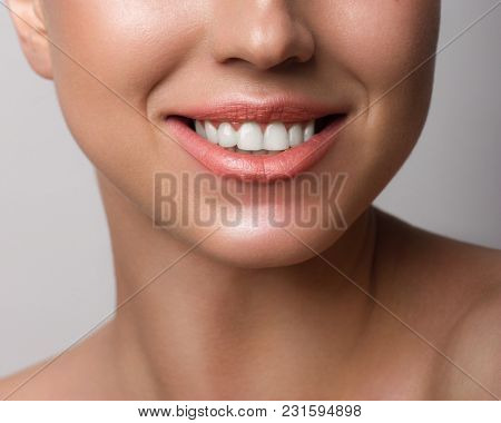 Beautiful Smile With Whitening Teeth. Dental Photo. Macro Closeup Of Perfect Female Mouth, Lips Care