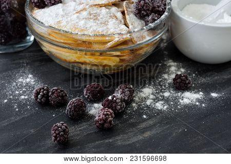 Homemade Pancakes With Blackberries, Powdered Sugar. Dark Background