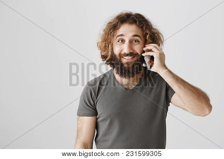 Guy Calls His Business Partner To Arrange Deal. Portrait Of Handsome Arabian Entrepreneur Talking On