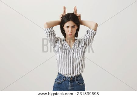 Do Not Play With My Feelings. Studio Shot Of Angry Cute European Female Girlfriend In Fashionable Cl