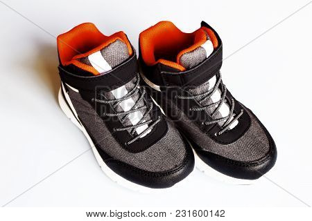 Pair Of Grey Kid Sneakers On White Background.