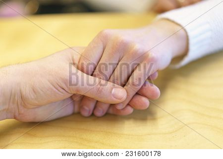 A Man's Hand Holds A Woman's Hand. Manifestation Of Love, Care And Friendship