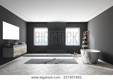 Interior Of A Modern Bathroom With Black Walls, A White Bathtub Standing On A Wooden Floor, A Double