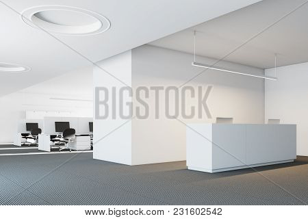 White Modern Office Reception Desk With Two Computers Standing In A Modern Company Headquarters. An