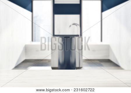 Loft Bathroom Interior With White And Dark Blue Walls, A Large Bathtub And A Sink With A Mirror Abov