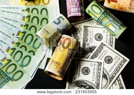 Close-up Of American Us Dollars And Euros