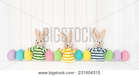 Easter Decoration Eggs And Funny Bunnies On Wooden Background