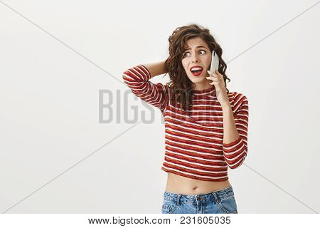 Girlfriend Received Call From Guy While Cheating On Him. Troubled Good-looking Female In Trendy Stri