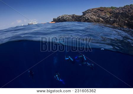 Scuba diving half and half split over under