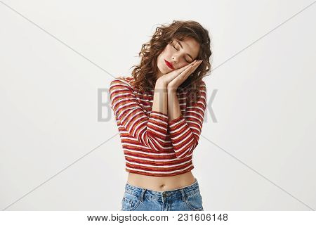 Tired Office Worker Taking Nap. Charming Caucasian Girl With Curly Hair Leaning On Palms And Standin