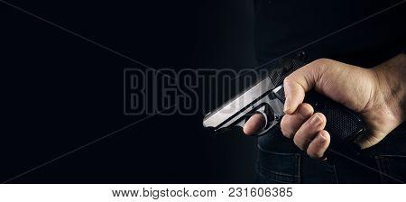 Hand Shooting Gun On Black Background Killer Concept.