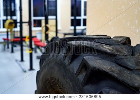 Modern Workout Gym For Fitness And Bodybuildiing With Tyre On The Front
