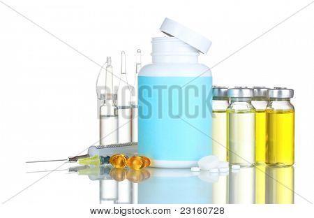 Medical bottles, ampoule, syringe and pills isolated on white