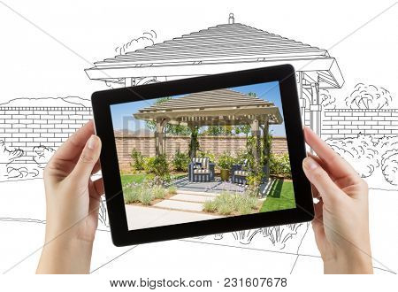 Female Hands Holding Computer Tablet with Photo of Pergola on Screen, Drawing Behind.